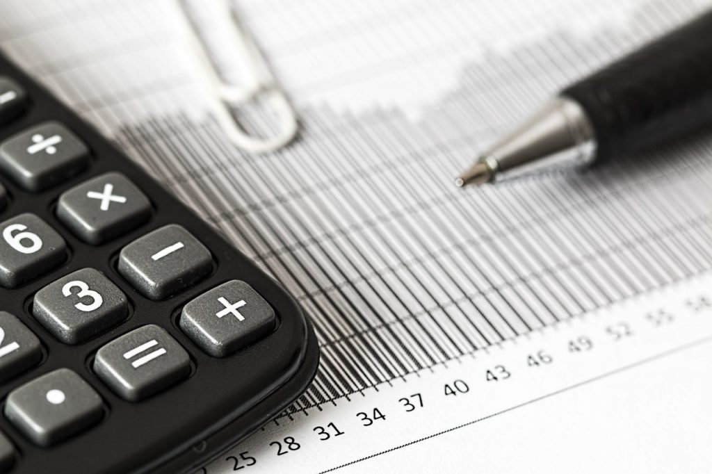 calculator and pen for investment analysis